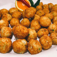 Pea and feta arancini balls by Cherry's Catering