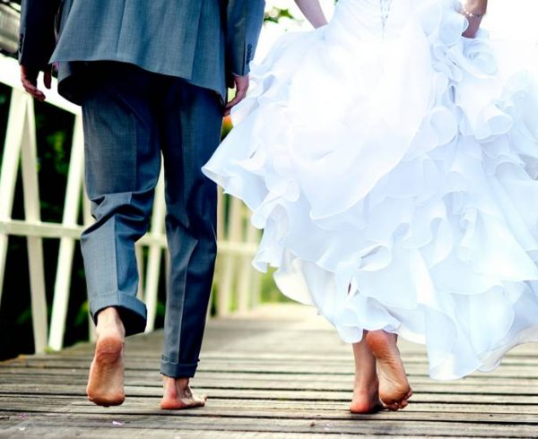 Married barefoot couple at their wedding
